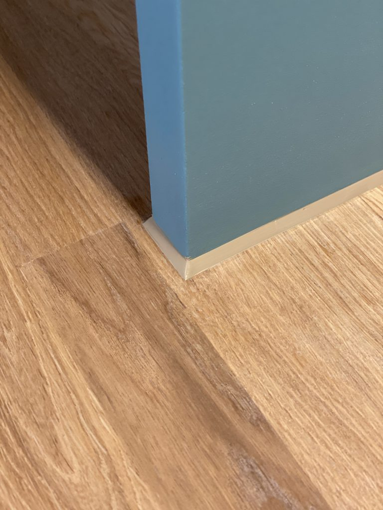 Sealant at the base of fitted furniture