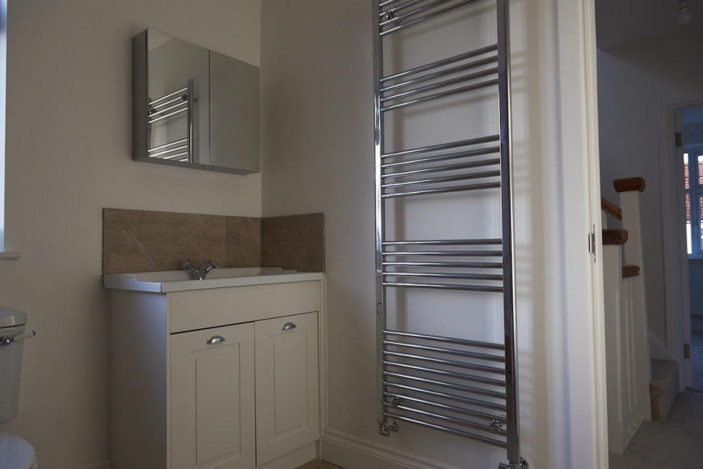 Sink and heated towel rail
