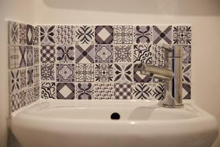 Tiling above sink